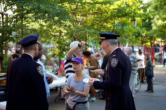 Members of the community discussing with NYPD officers at the Night Out Against Crime