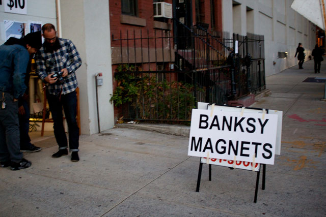 Cheap unofficial Banksy memorabilia for sale near the artwork