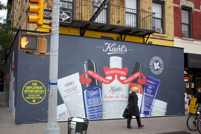 The branded plywood surrounding the future Kiehl's store