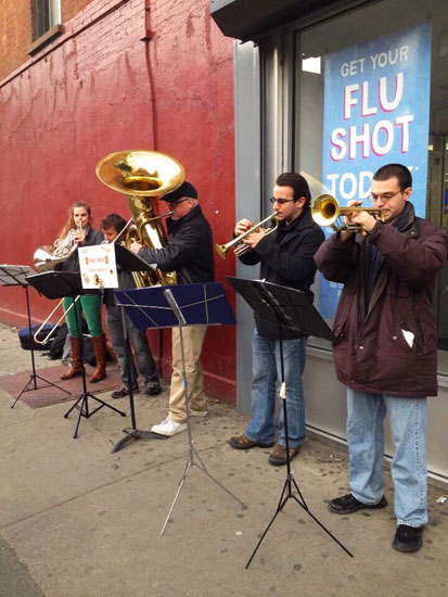 A brass quintet playing on the street