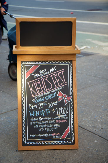 The sidewalk signage announcing the Kiehl's opening promotions