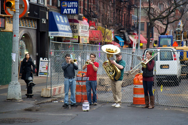 A brass quartet performing on the street