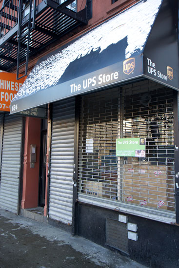 The exterior of the closed UPS Store franchise