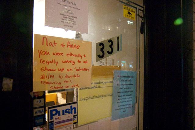 A notice from a customer on the outside of the closed UPS Store on W 57th