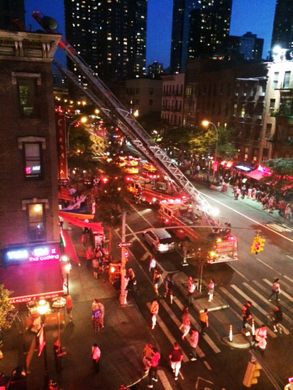 Fire engines and the crowd at the incident on 46th St