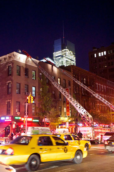 Fire engines with ladders up at the incident on 46th St