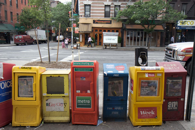 A row of newspaper stands along 9th Avenue
