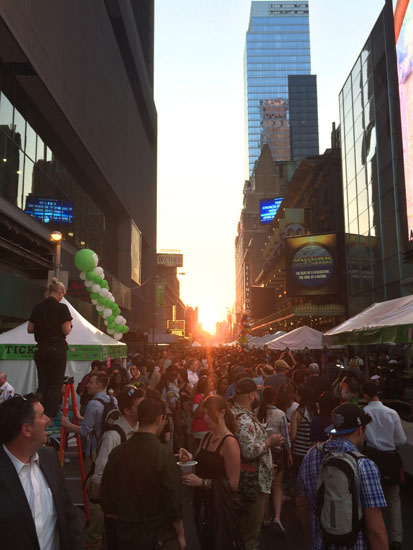 Manhattanhenge over the top of the Taste of Times Square festival