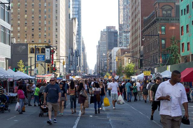Crowds at the 8th Ave street fair
