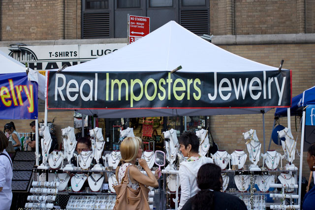 "A ""Real Imposters Jewelry"" stall at the 8th Ave street fair"