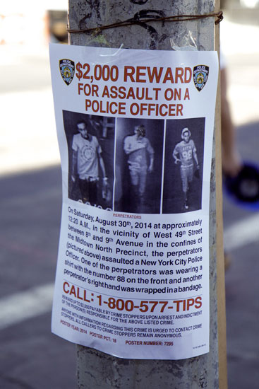 A flyer calling for information on an assault on a police officer